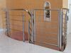Schutztür aus Edelstahl nachträglich an einer steilen Innentreppe montiert