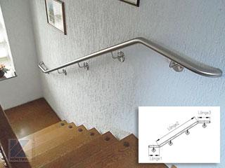Treppenhandlauf aus Edelstahl an Innentreppe - zweimal gebogen mit waagerechten Auslauf der Handlaufenden