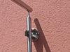 Edelstahlgeländer mit Glasfüllung - Sonderbefestigungslösung an der Hauswand mit einer zweiten Wangenplatte