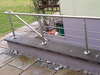 Handlauf an Außentreppe mit Brüstungsgeländer aus Edelstahl