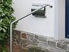 Geländerbügel in Sonderanfertigung, seitlich an der Treppe einbetoniert